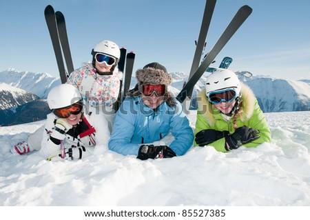 Happy ski vacation - skiers portrait - stock photo