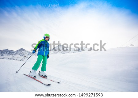Happy skier sliding fast while skiing on slope #1499271593