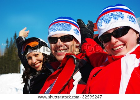 Happy skiers resting on ski resort