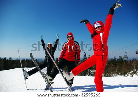 Happy skiers resting on ski resort