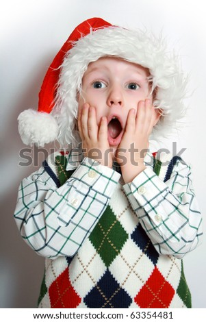 happy small boy with santa-hat, smiling - stock photo