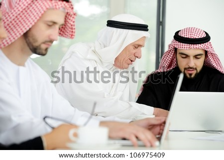 Happy smart business man arabic with team mates - stock photo