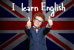 Happy smart successful child boy is ready for English exam. Learn English concept