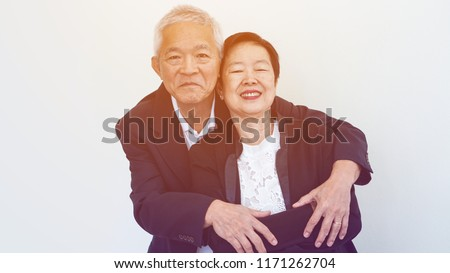 Happy smile Asian elderly couple in business attire, SME family owner