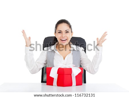happy smile excited business woman red gift box with bow sitting at the desk, isolated over white background