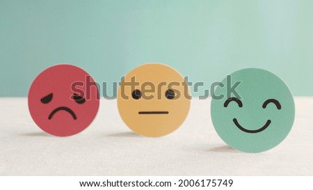 Happy smile face paper cut, good feedback rating and positive customer review, experience, satisfaction survey ,mental health assessment, child wellness,world mental health day concept