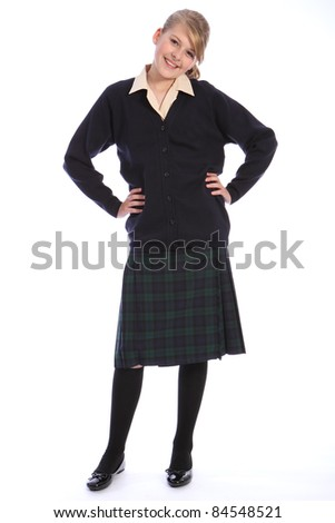 Happy smile from beautiful teenage high school student girl wearing school uniform, tartan skirt and beige shirt with navy cardigan.
