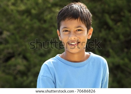 Happy smile from young boy in countryside sunshine