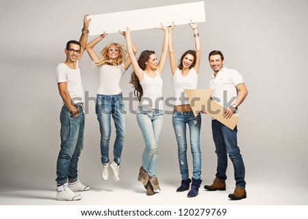 Happy smile group of young people holding a blank white card board