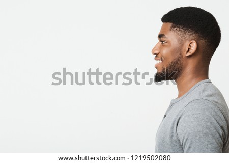 Happy smiling african-american man profile portrait. Black guy looking aside at copy space Stock photo ©