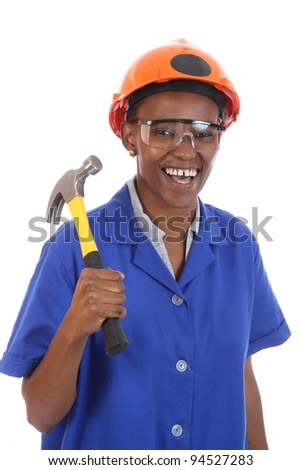 Happy smiling African ethnic lady with hammer and protective safety glasses and hat