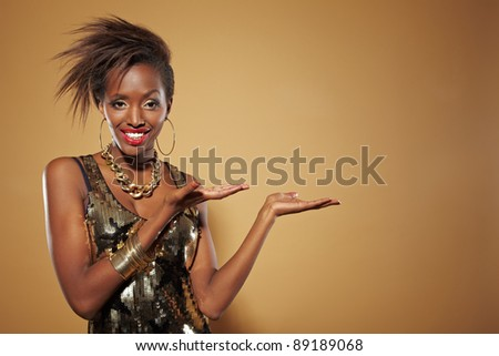 Happy smiling african woman presenting an imaginary product