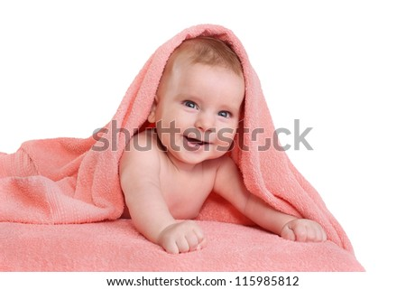 Happy smiling baby in pink towel