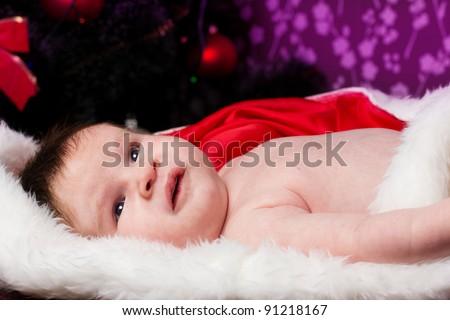 Happy Smiling baby lying on tummy wearing - stock photo