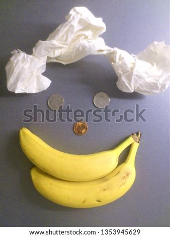 Happy Smiling Banana Coin Dude Face