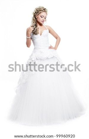 Happy smiling beautiful bride blond girl in white wedding dress with hairstyle and bright makeup on white background full length