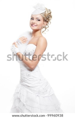 Happy smiling beautiful bride blond girl in white wedding dress with hairstyle and bright makeup on white background