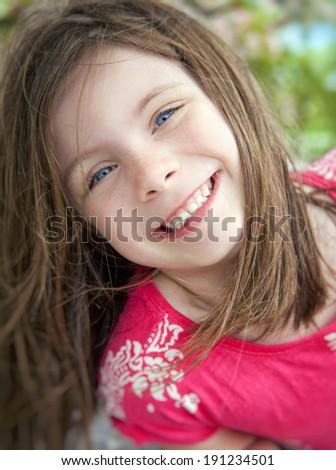 Happy smiling beautiful girl portrait