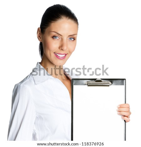 Happy smiling beautiful young business woman showing blank clipboard, isolated over white background