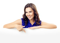 Happy smiling beautiful young woman in blue smart casual clothing showing blank signboard or copyspace for slogan or text, isolated against white background