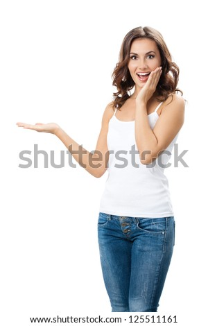 Happy smiling beautiful young woman showing copyspace or something, isolated over white background