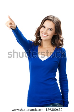 Happy smiling beautiful young woman showing forward to copyspace, visual imaginary or something, or pressing virual button isolated over white background