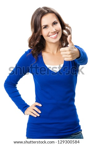 Happy smiling beautiful young woman showing thumbs up gesture, isolated over white background