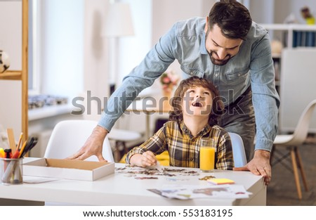 Happy smiling boy keeping his head upwards #553183195