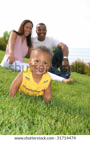 Happy smiling Boy Playing Outdoor with Parents In Summer Sunny Day
