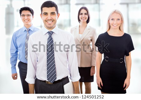 Happy smiling business team standing in a row