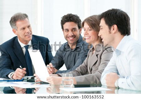 Happy smiling business team working together at office