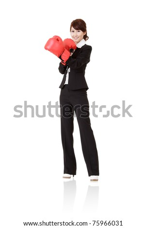 Happy smiling business with red boxing glove, full length portrait isolated on white background.