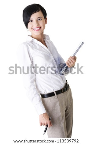 Happy smiling business woman or student in elegant clothes holding notebook and pen, isolated on white background
