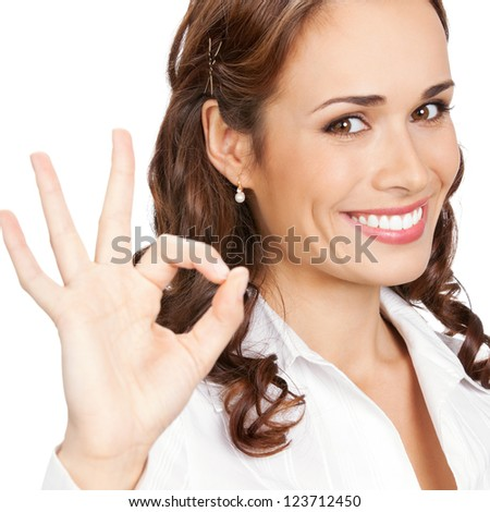 Happy smiling business woman with okay gesture, isolated over white background