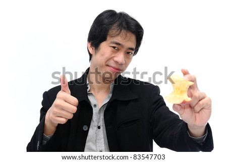 Happy smiling businessman showing thumbs up gesture with apple, isolated on white background