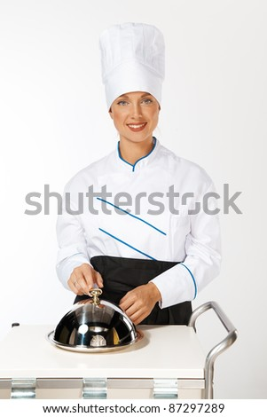 happy smiling caucasian female chef introducing new dish