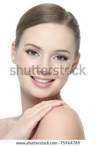 Happy smiling cheerful face of young beautiful woman isolated on white background