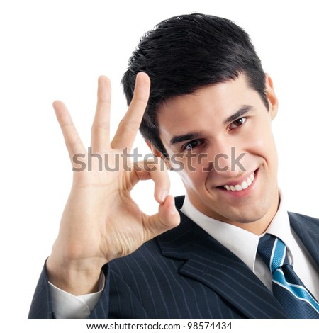 Happy smiling cheerful young business man with okay gesture, isolated over white background