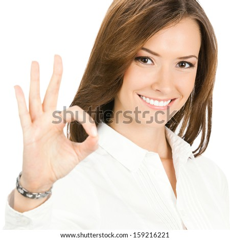 Happy smiling cheerful young business woman with okay gesture, isolated over white background