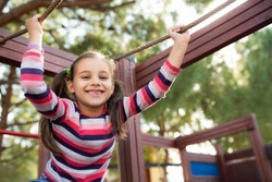 Happy Smiling Child Girl Playing At Playground Outdoors In Park