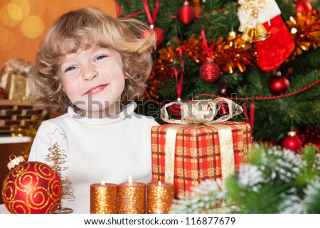 Happy smiling child with Christmas decorations