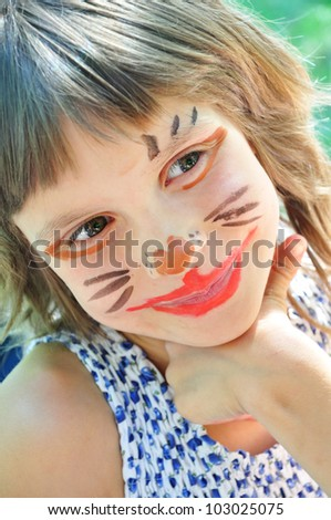 happy smiling child with funny painted face