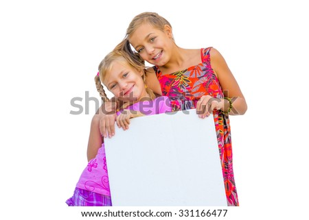 Happy smiling children girls holds blank banner or empty paper isolated on white background #331166477