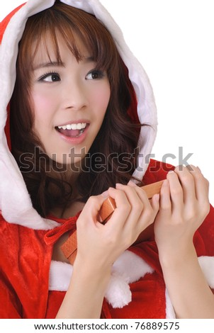Happy smiling Christmas girl holding gift box and looking, half length closeup portrait on white background.