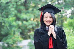 happy smiling college student graduating; concept of successful education, happy commencement day, woman education equality, employment opportunity, high education degree, overseas study scholarships