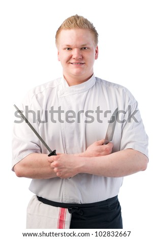 Happy smiling cook holding knife and sharpener