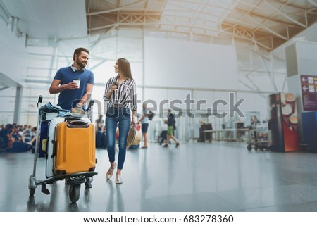 Happy smiling couple in airport