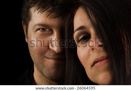 Happy smiling couple in love. Over black background