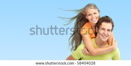 Happy smiling couple in love. Over blue background
