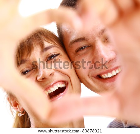 Happy smiling couple in love, over white background